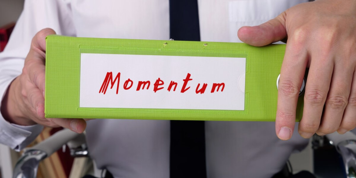 momentum printed on the spine of a binder_canstockphoto88159345 1200x600